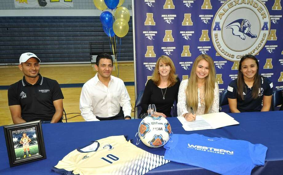 Alexander girls' soccer player Lillyann Beltran signed her national letter of intent on Thursday to join Western Texas College next year. Beltran, second to right, was joined by WTC assistant coach Jovany Macias, parents Harry and Michelle Beltran and Alexander coach Erica Alcaraz. Photo: Courtesy Of UISD Athletics