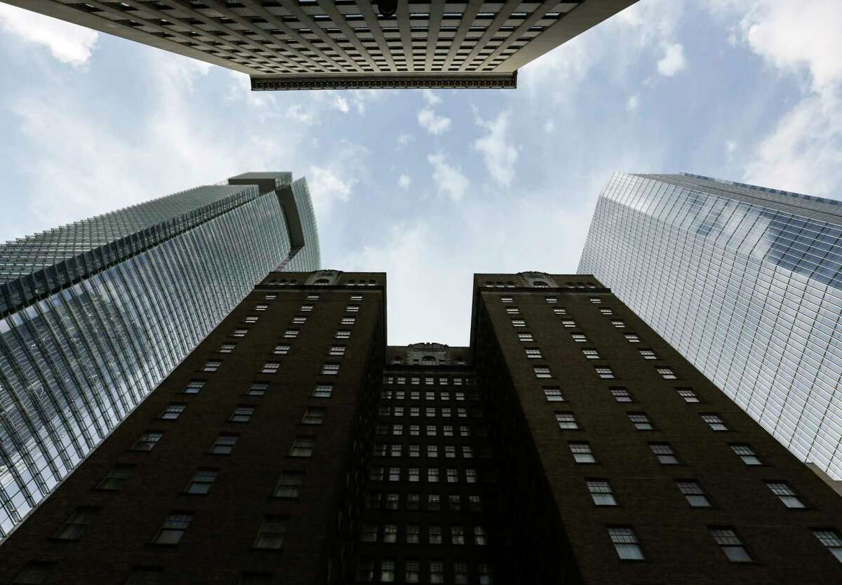 Like siblings: BG Group Place, at left, and 609 Main, at right, both developed by Hines and designed by Pickard Chilton.