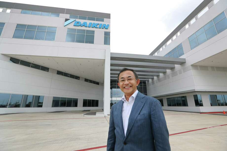 "Takeshi Ebisu, President and CEO of Daikin North America poses for a photo Wednesday, May 10, 2017, in Waller. Daikin's Waller plant  opens on May 24.  It is the world's largest  building of this particular construction type (called ""tilt-wall""). It's four million square feet, about the size of 40 city blocks, or 91 acres. The plant bring several thousand manufacturing jobs to Houston when it opens. They make air conditioning, heating and ventilation units.  ( Steve Gonzales  / Houston Chronicle ) Photo: Steve Gonzales, Staff / © 2017 Houston Chronicle"