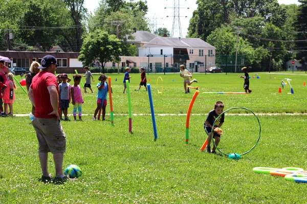 """Leclaire Elementary School celebrated its end-of-the-year celebration, """"Leclaire Lollapalooza,"""" formerly known as the """"Ocean Olympics,"""" Thursday, May 18. Unlike last year, the activities didn't feature water. The field day consisted of outdoor games with scooters, slingshots, and obstacle courses on the playground, as both students and faculty participated."""