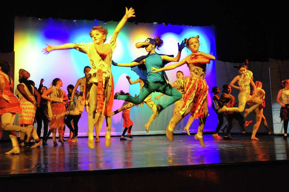 "From left, Trinity Catholic Middle School students Michael McArthur, as Young Simba, Sabrina Sgandurra, as Zazu, and Grayce Journick, as Young Nala, during a rehearsal for ""The Lion King Jr."" Photo: Contributed / Trinity Catholic Middle School"
