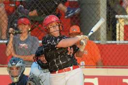 Alyssa LeBlanc (11) of Katy watches a ball sail over the fence for a home run to lead off the third inning of an regional semifinal playoff softball game between the Katy Tigers and the Atascocita Eagles on Thursday May 18, 2017 at Katy HS, Katy, TX.