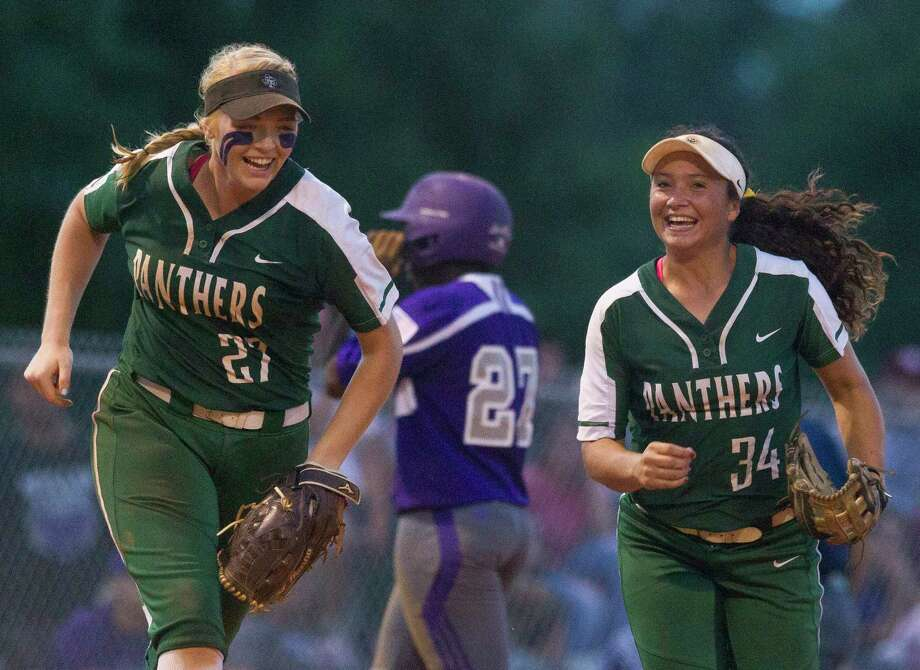 Kingwood Park third baseman Alyssa Forrester (27) smiles along side Kingwood Park shortstop Nikki Whitehead (34) after Forrester caught Willis Taylor Rightmire's fly ball during the fifth inning in Game 1 of a Region III-5A semifinal series Thursday, May 18, 2017, in Kingwood. Photo: Jason Fochtman, Houston Chronicle / © 2017 Houston Chronicle