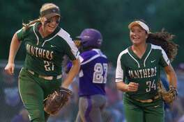 Kingwood Park third baseman Alyssa Forrester (27) smiles along side Kingwood Park shortstop Nikki Whitehead (34) after Forrester caught Willis Taylor Rightmire's fly ball during the fifth inning in Game 1 of a Region III-5A semifinal series Thursday, May 18, 2017, in Kingwood.