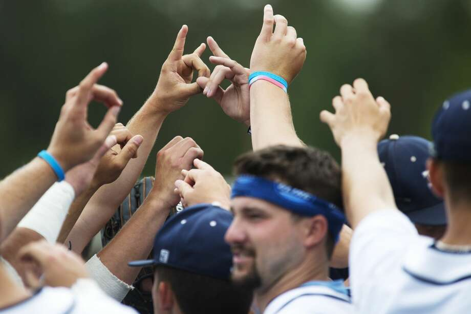 Members of the Northwood University baseball team rally before playing in a game against Kentucky Wesleyan at Northwood on Thursday. Photo: Theophil Syslo