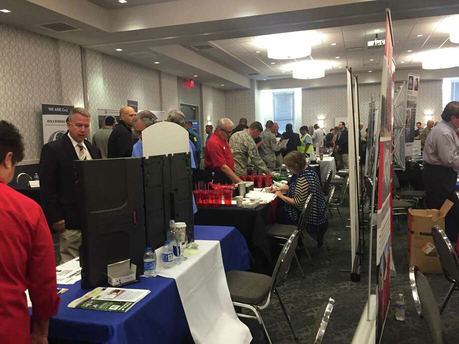 Active military and veterans confer with employers at this week's RecruitMilitary job fair at the Norris Conference Centers, attended by about 500 job seekers. Photo: David Hendricks