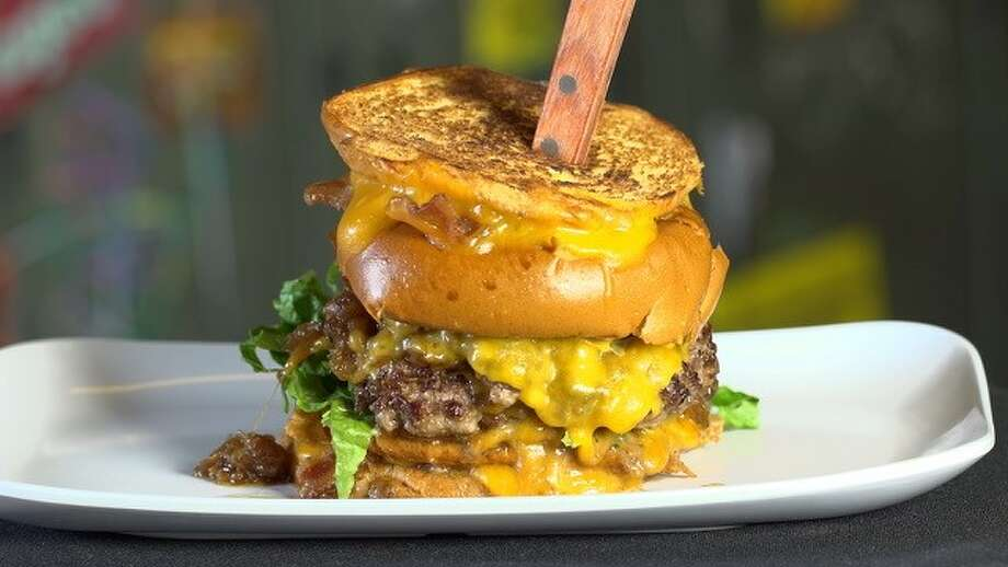 """The Detention Burger at Bernie Burger Bus, built with two melted cheddar cheese patties, """"tipsy"""" onions and ALL the principal's fixings on two crispy bacon grilled cheeses used as a bun."""