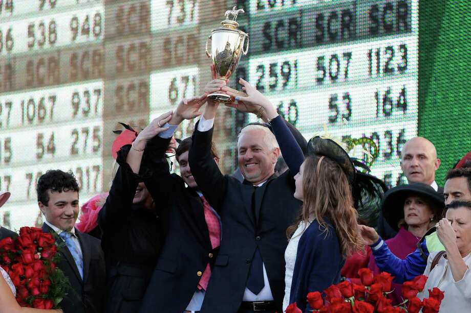Trainer Todd Pletcher holds up the trophy after Always Dreaming won the 143rd running of the Kentucky Derby at Churchill Downs on May 6, 2017 in Louisville. Photo: Jamie Squire /Getty Images / 2017 Getty Images
