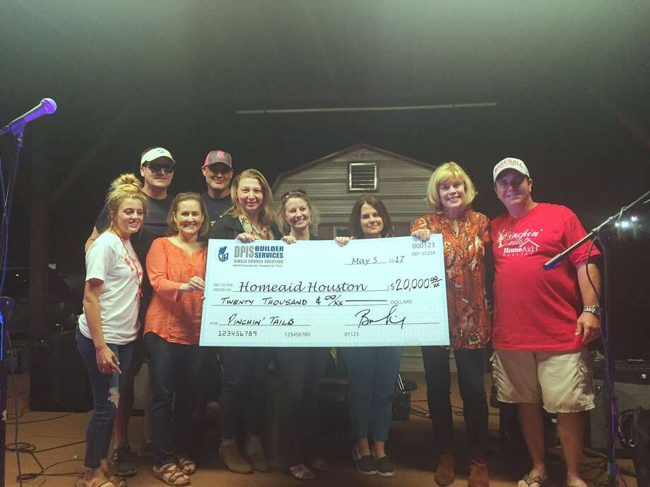 From left, Tessa Martin, DPIS; Greg Tomlinson, Builders Post Tension; Sheri Douglass, HomeAid; Jennifer Wall, BMC; Cindy Hinson, Lennar/Village Builders; Tasha Steiner, On-Target; Bette Moser, HomeAid and Brannon King, DPIS display the check by DPIS Engineering crawfish boil fundraiser for HomeAid Houston.