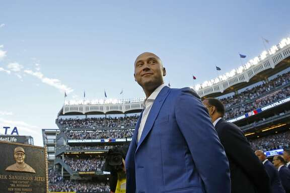 Retired New York Yankees shortstop Derek Jeter takes it all in during a pregame ceremony retiring his number 2 at Yankee Stadium in New York, Sunday, May 14, 2017.  (AP Photo/Kathy Willens)