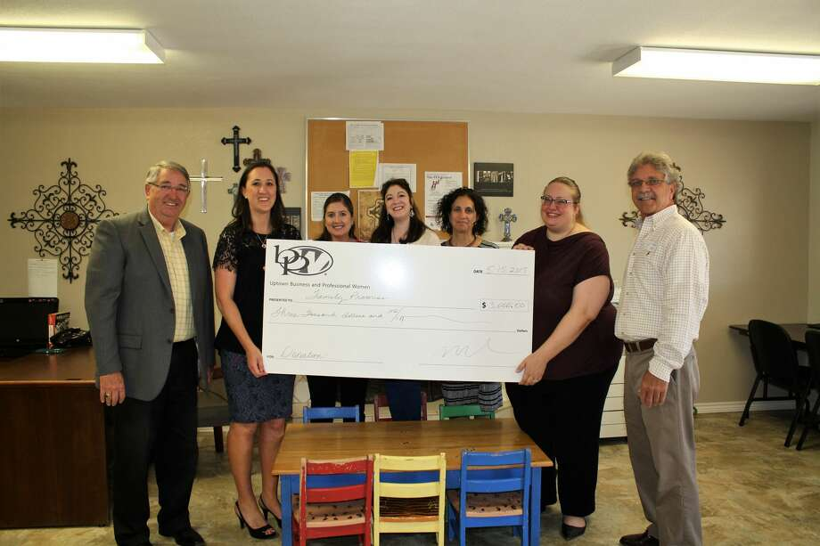 The Uptown Midland Business and Professional Women organization on Tuesday made a $3,000 donation to Family Promise. The funds will help the nonprofit organization's clients purchase clothing to for transitioning to school and the work force. Photo: Courtesy Photo