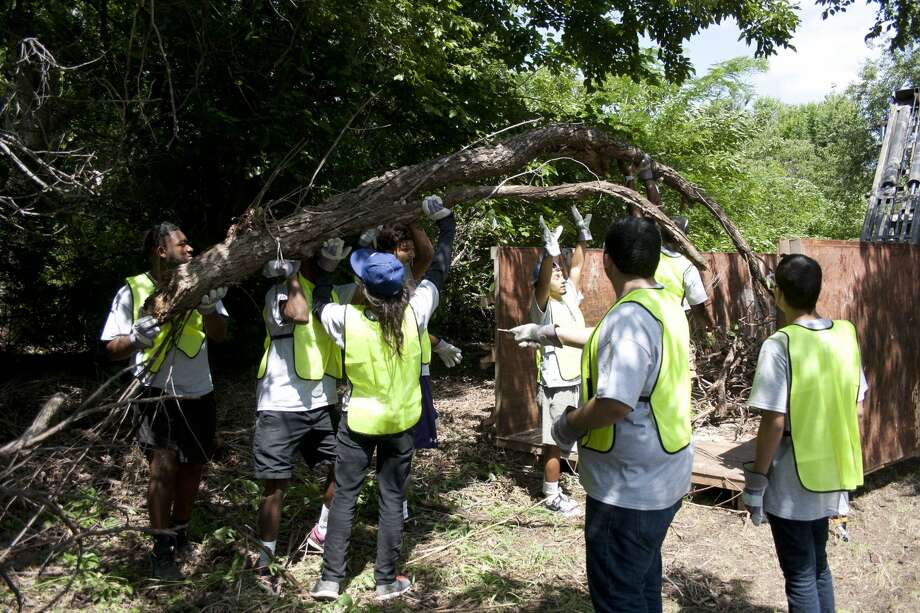 XY Zone students clean out brush in last year's service project. Photo: Courtesy Photo