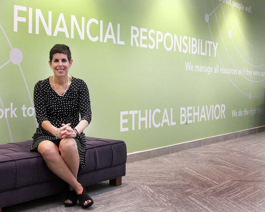 Amy Meichner, senior vice president of human resources, sits near a wall that highlights Cartus's values at the company's headquarters in Danbury, Conn., on Tuesday, May 16, 2017. Photo: Chris Bosak / Hearst Connecticut Media / The News-Times