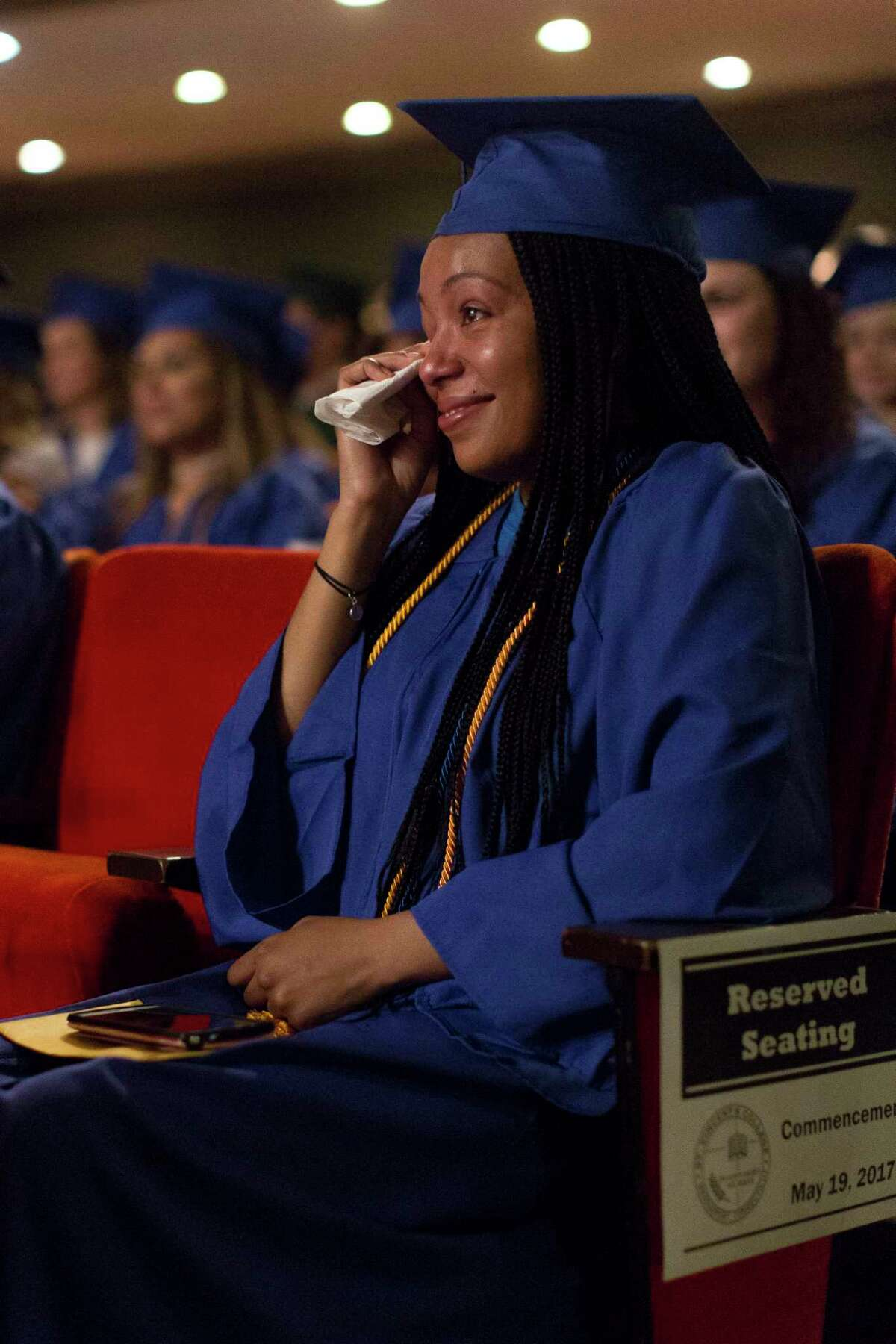Graduate Sherdley Jean-Charles, of Bridgeport, wipes away happy tears at the St. Vincent College's Commencement Ceremoy on Friday, May 19, 2017 in Bridgeport, Conn.