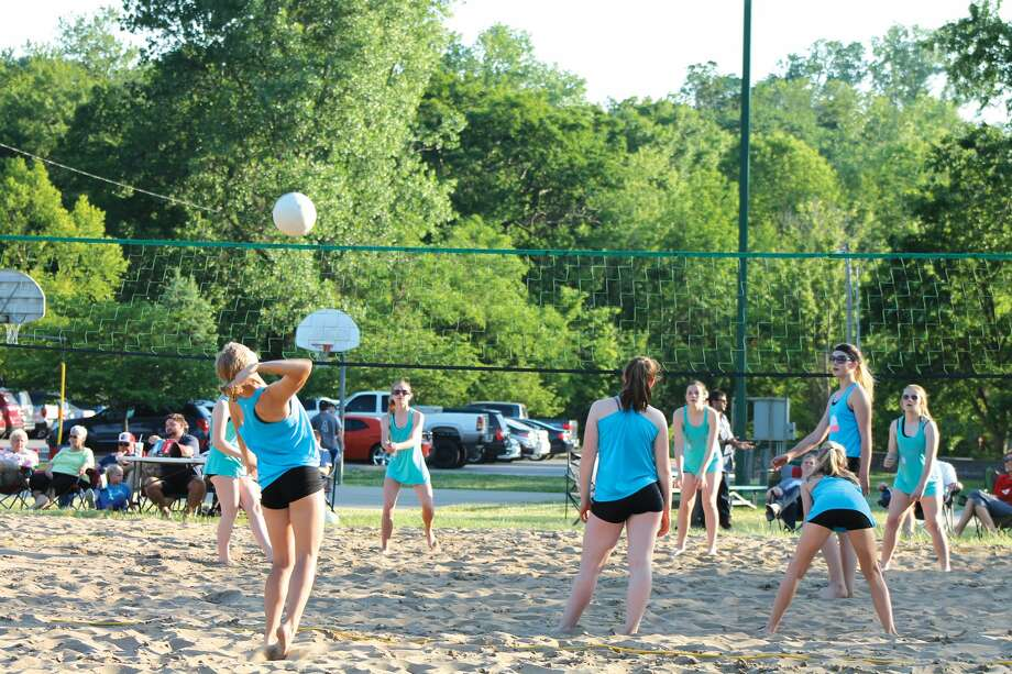 A youth volleyball participant goes up for a serve. Photo: Bill Tucker • Intelligencer
