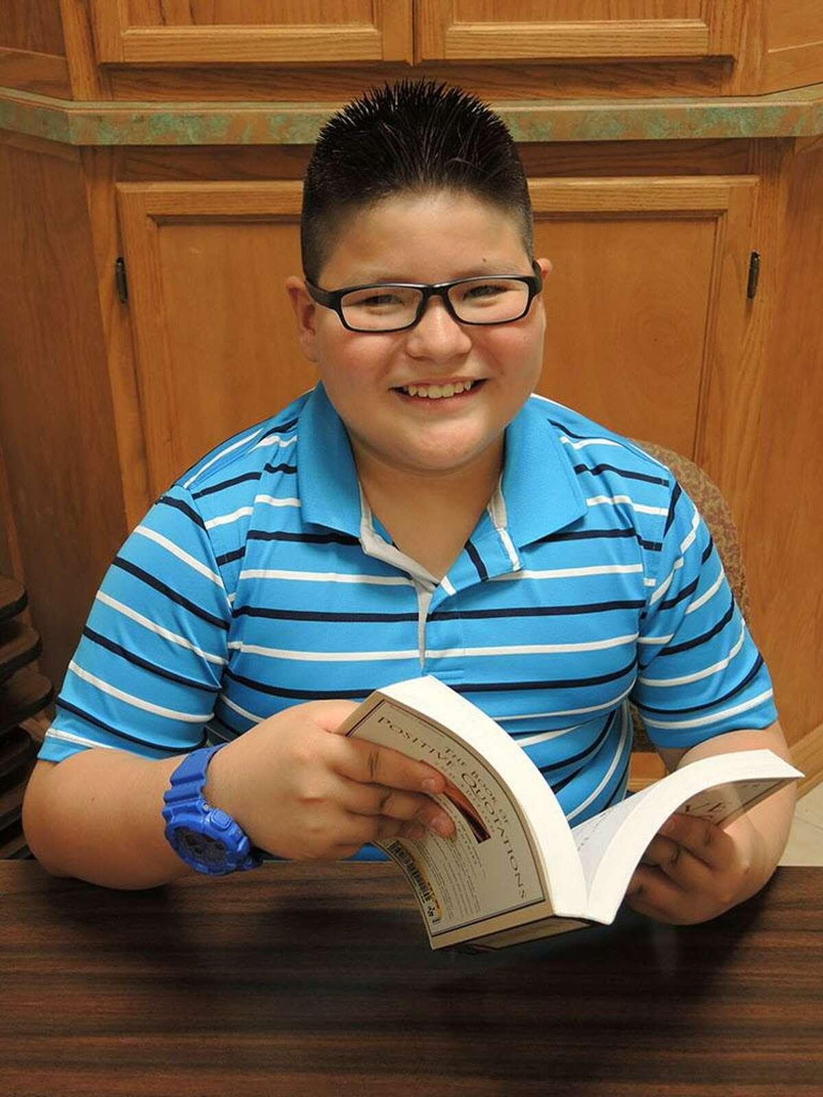 Isidro Mercado, a 4th grade student, enjoys reading a good book.