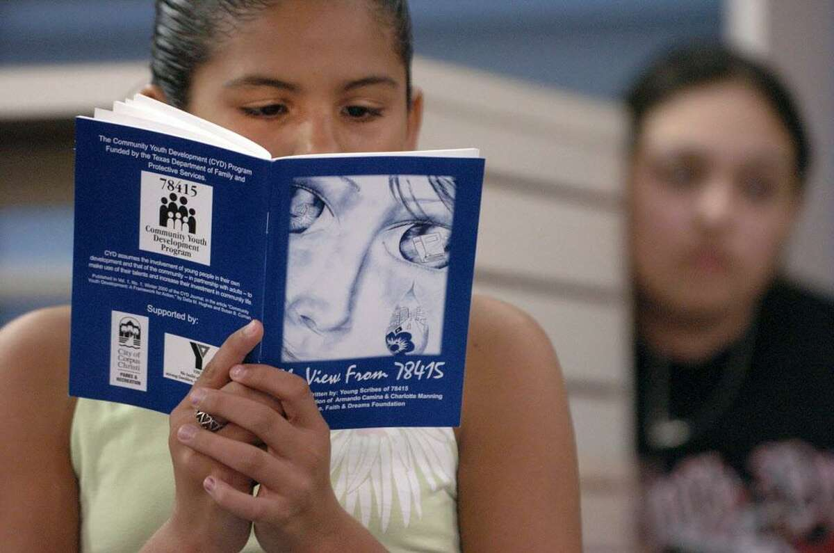 Sarah Colunga,11, reads from the book a poem she wrote called
