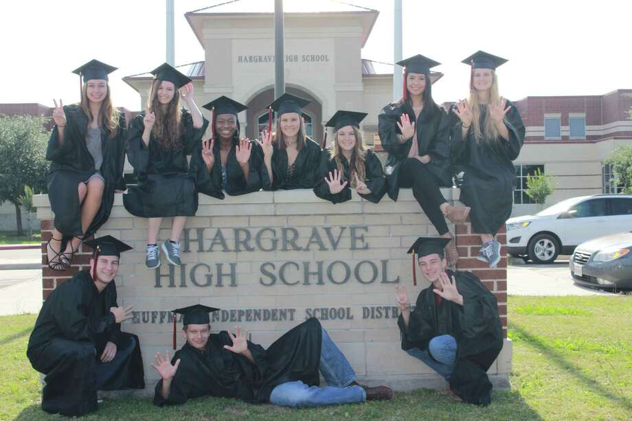 Hargrave High School top 10 graduates pose around the Hargrave High School sign May 8. (Left to right) Top row: Dalaina Dreymala, Amber Zschokke, Aliece Milton, Aryn Lynn James, Cynthia Renae Colbert, Denise Diosdado, Cameron Taylor. Bottom row: Austin Gee, Devin Kelly, Trevor Jake Asher. Photo: Courtesy Of Hargrave High School Yearbook