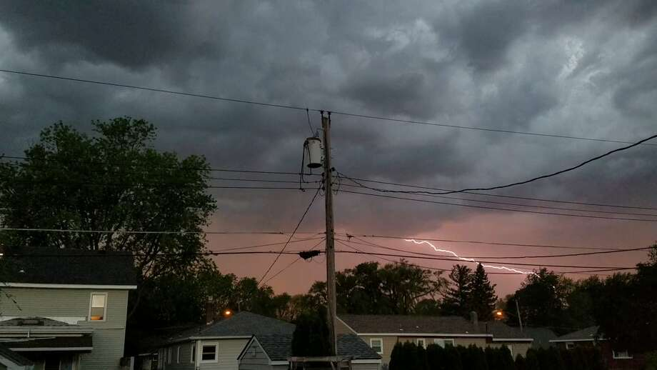 Lightning lights up the night sky over Albany on Thursday. Thunderstorms hit the area hard, leaving thousands of National Grid customers without utility service. Photo: Eric Platt / Special To The Times Union