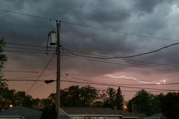 Lightning lights up the night sky over the Capital Region on Thursday. Thunderstorms hit the area hard, leaving thousands of National Grid customers without utility service.