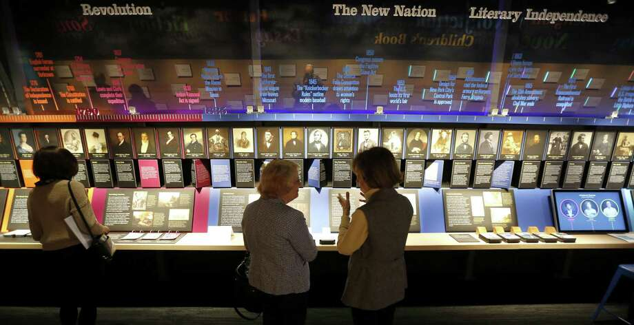 "Visitors at the American Writers Museum look at a timeline display that celebrates authors who are emblematic of ""American Voices"" at the new museum in Chicago. Photo: Charles Rex Arbogast /Associated Press / Copyright 2017 The Associated Press. All rights reserved."