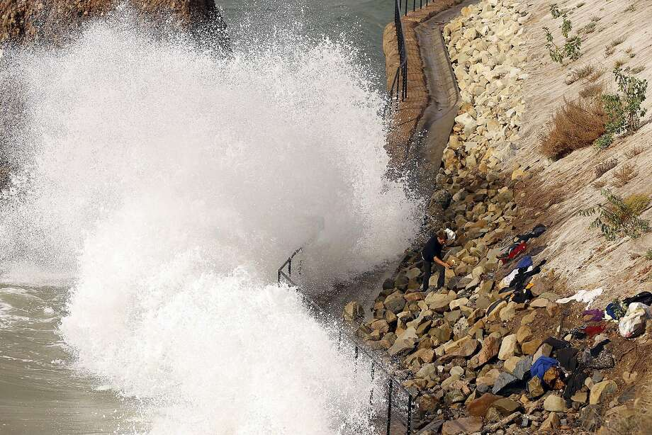High surf crashes into the sea wall near Big Rock on Will Rogers State Beach along the Pacific Coast Highway in Pacific Palisades on Oct. 27, 2015. A new study finds that rising sea levels will double the risk of flooding along the West Coast and elsewhere. (Al Seib/Los Angeles Times/TNS) Photo: Al Seib, TNS