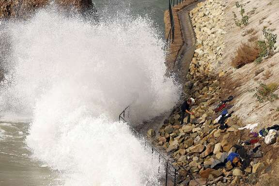 High surf crashes into the sea wall near Big Rock on Will Rogers State Beach along the Pacific Coast Highway in Pacific Palisades on Oct. 27, 2015. A new study finds that rising sea levels will double the risk of flooding along the West Coast and elsewhere. (Al Seib/Los Angeles Times/TNS)