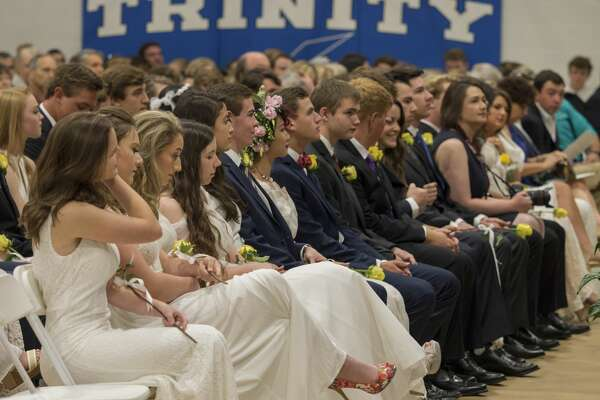 Trinity School graduates listen to awards as they are announced 5/19/17 during commencement ceremonies. Tim Fischer/Reporter-Telegram