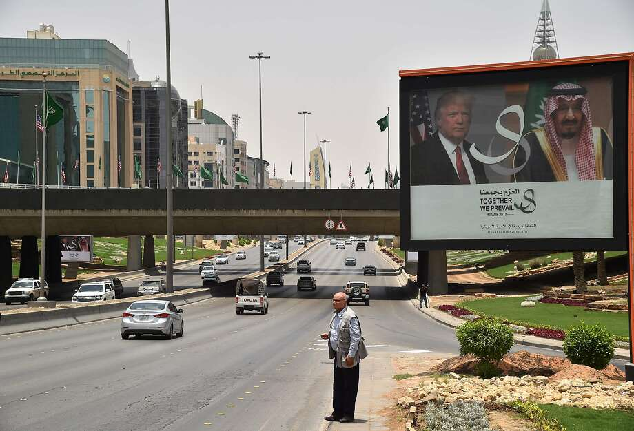 A billboard with photos of President Trump and King Salman looms over a street in Riyadh, Saudi Arabia. Photo: GIUSEPPE CACACE, AFP/Getty Images