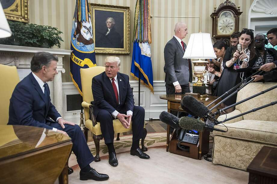 President Trump hosts Colombian President Juan Manuel Santos in the Oval Office on Thursday. Afterward, he denied asking then-FBI Director James Comey in February to drop the investigation of fired national security adviser Michael Flynn's ties to Russia. Photo: Jabin Botsford, The Washington Post