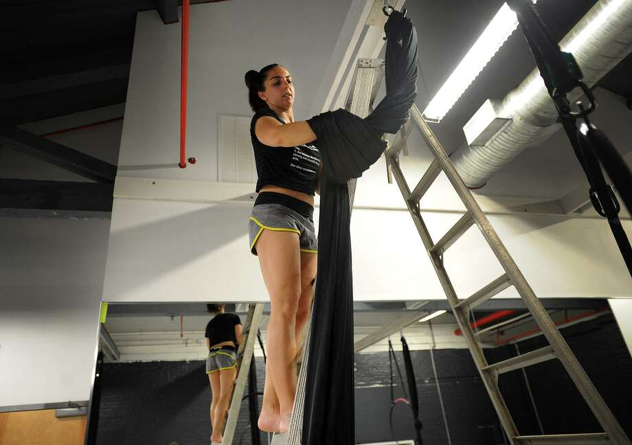 Ashely Popoli, of Stamford, hangs aerial silks in preparation for the grand opening of the new Vertical Addiction aerial fitness studio at 85 Mill Plain Road in Fairfield, Conn. on Thursday, May 18, 2017. Photo: Brian A. Pounds / Hearst Connecticut Media / Connecticut Post