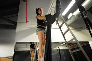 Ashely Popoli, of Stamford, hangs aerial silks in preparation for the grand opening of the new Vertical Addiction aerial fitness studio at 85 Mill Plain Road in Fairfield, Conn. on Thursday, May 18, 2017.
