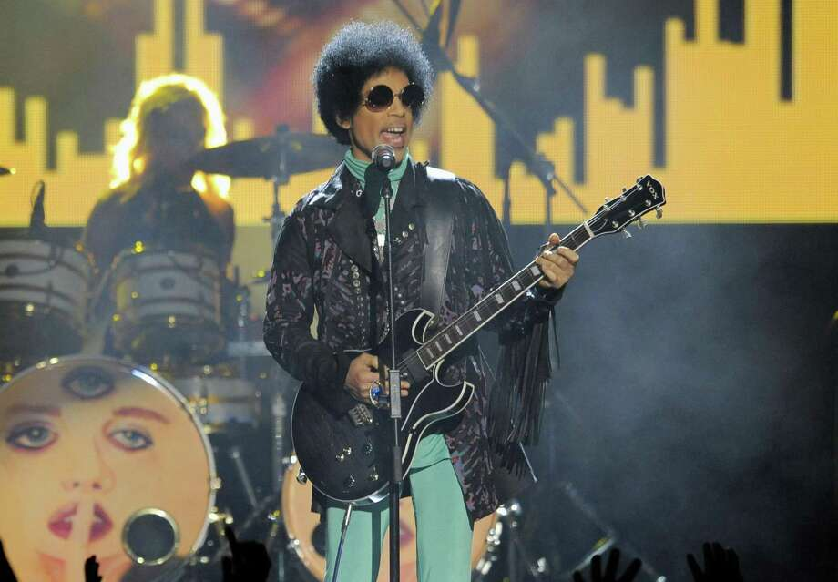 In this photo from May 19, 2013, Prince performs at the Billboard Music Awards at the MGM Grand Garden Arena in Las Vegas. In a ruling made public Friday, a Minnesota judge ruled that Prince's six siblings are the heirs to his estate, more than a year after the pop superstar died of a drug overdose. Photo: Associated Press File Photo / Invision