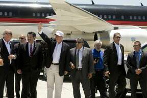 US Presidential candidate Donald Trump with local Laredo, Texas officials including Mayor Pete Saenz and Laredo City Manager Jesus M. Olivares upon Mr. Trump's arrival at the Laredo airport on July 23, 2015 (Photo by Robert Daemmrich Photography Inc/Corbis via Getty Images)