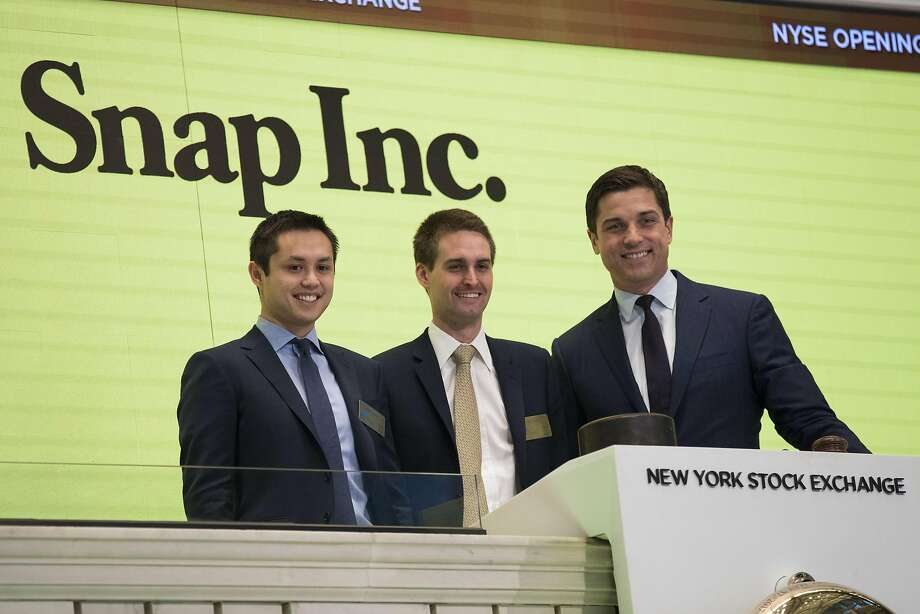 FILE: Snap Inc. reported 166 million active users for a growth rate of 5 percent in 2017 Q1. NEW YORK, NY - MARCH 2: (L to ) Snapchat co-founders Bobby Murphy, chief technology officer of Snap Inc., and Evan Spiegel, chief executive officer of Snap Inc., prepare to ring the opening bell as Thomas Farley, president of the NYSE, looks on, March 2, 2017 in New York City. Snap Inc. priced its initial public offering at $17 a share on Wednesday and Snap shares will start trading on the New York Stock Exchange (NYSE) on Thursday. (Photo by Drew Angerer/Getty Images) Photo: Drew Angerer