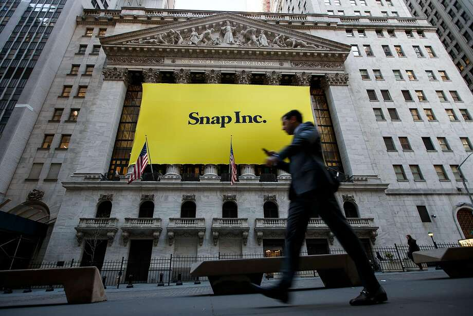 FILE: Snap Inc. reported 166 million active users for a growth rate of 5 percent in 2017 Q1. NEW YORK, NY - MARCH 2: Signage for Snap Inc., parent company of Snapchat, adorns the front of the New York Stock Exchange (NYSE), March 2, 2017 in New York City. Snap Inc. priced its initial public offering at $17 a share on Wednesday and Snap shares will start trading on the New York Stock Exchange (NYSE) on Thursday. (Photo by Drew Angerer/Getty Images) Photo: Drew Angerer