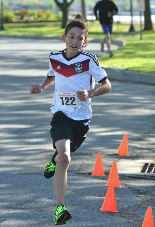Darien's Lucas Madariage, 14, runs to a first-place finish in his division at a Mother's Day race on May 14 in Norwalk. Photo: Alex Von Kleydorff / Hearst Connecticut Media / Norwalk Hour