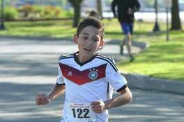Darien's Lucas Madariage, 14, runs to a first-place finish in his division at a Mother's Day race on May 14 in Norwalk.