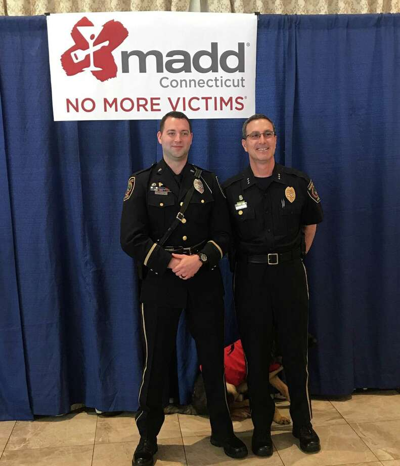 Redding Police Officer Michael Livingston (left) received a MADD Award Thursday from CT MADD in recognition of his enforcement efforts. Redding Police Chief Doug Fuchs is pictured right. Photo: Contributed Photo