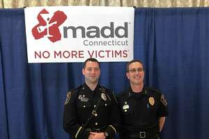 Redding Police Officer Michael Livingston (left) received a MADD Award Thursday from CT MADD in recognition of his enforcement efforts. Redding Police Chief Doug Fuchs is pictured right.