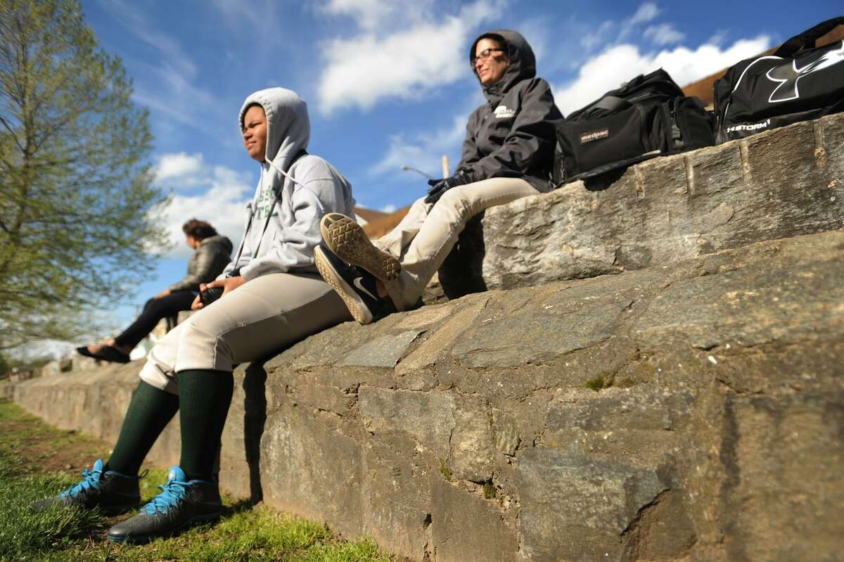 Bassick High softball player Laquasha Johnson, 15, and athletic trainer Tara Murphy watch the team play from a low stone wall, a remnant of the old foundation of Barnum's circus winter quarters, at Went Field in Bridgeport, Conn. on Monday, May 8, 2017.