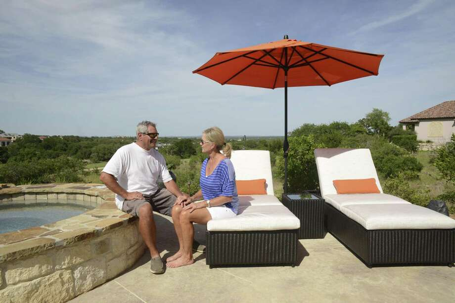 Rod and Paula Alexander relax by their pool at their home at Cordillera Ranch. They say that although they live in an affluent community, the residents are humble and friendly. They moved to the Hill Country community from the Texas Panhandle. Photo: Billy Calzada /San Antonio Express-News / San Antonio Express-News