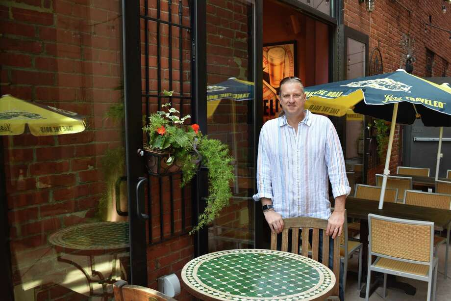 Cask Republic owner Christian Burns on Friday, May 19, 2017, in the restaurant's courtyard patio on Washington Street in South Norwalk, Conn. Photo: Alexander Soule / Hearst Connecticut Media / Stamford Advocate