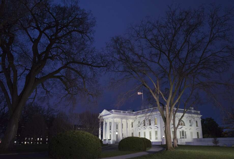 A January 12, 2016 photo shows the White House at dusk in Washington, DC.  US President Barack Obama is set to deliver his final State of the Union address this evening. Photo: MANDEL NGAN/AFP/Getty Images