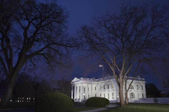 A January 12, 2016 photo shows the White House at dusk in Washington, DC.  US President Barack Obama is set to deliver his final State of the Union address this evening.