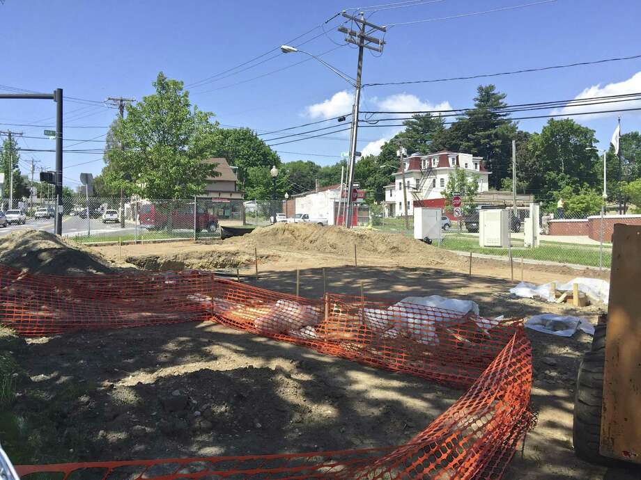 Work is underway on a small memorial park on Main Street near Danbury police headquarters. Friday, May 19, 2017, in Danbury, Conn. Photo: Rob Ryser / Hearst Connecticut Media / The News-Times