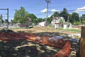 Work is underway on a small memorial park on Main Street near Danbury police headquarters. Friday, May 19, 2017, in Danbury, Conn.