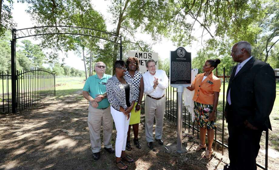 Pilgrim Branch Baptist Church members gather to unveil the official Texas Historical Marker at their Amos Cemetery Saturday, Sept. 24, 2016, in Houston. Special guests are (from left): Paul R. Scott from Harris County Information Technology Center, Joanne Green and Cathyrine Stewart of Kohrville Community Amos Cemetery Association Committees, Mark Seegers representing Harris County Precinct 4 commissioner,  Debra Blacklock-Sloan from Harris County Historical Commission and Pastor Freddie Solomon with Carverdale Community Church of God in Christ. (Yi-Chin Lee / Houston Chronicle ) Photo: Yi-Chin Lee, Staff / © 2016  Houston Chronicle