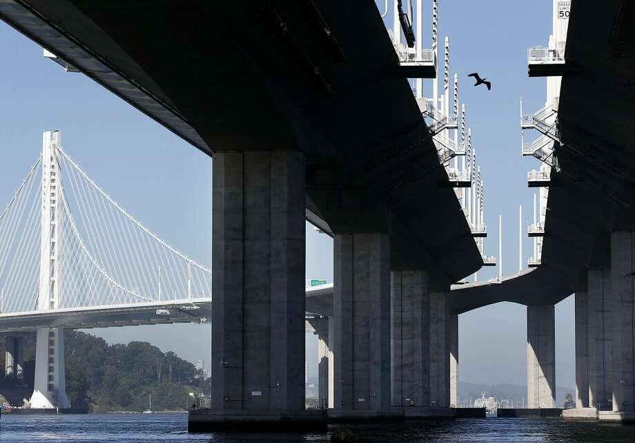 A cormorant flies between both viaducts of the eastern Bay Bridge, where nesting platforms are installed. Photo: Paul Chinn, The Chronicle