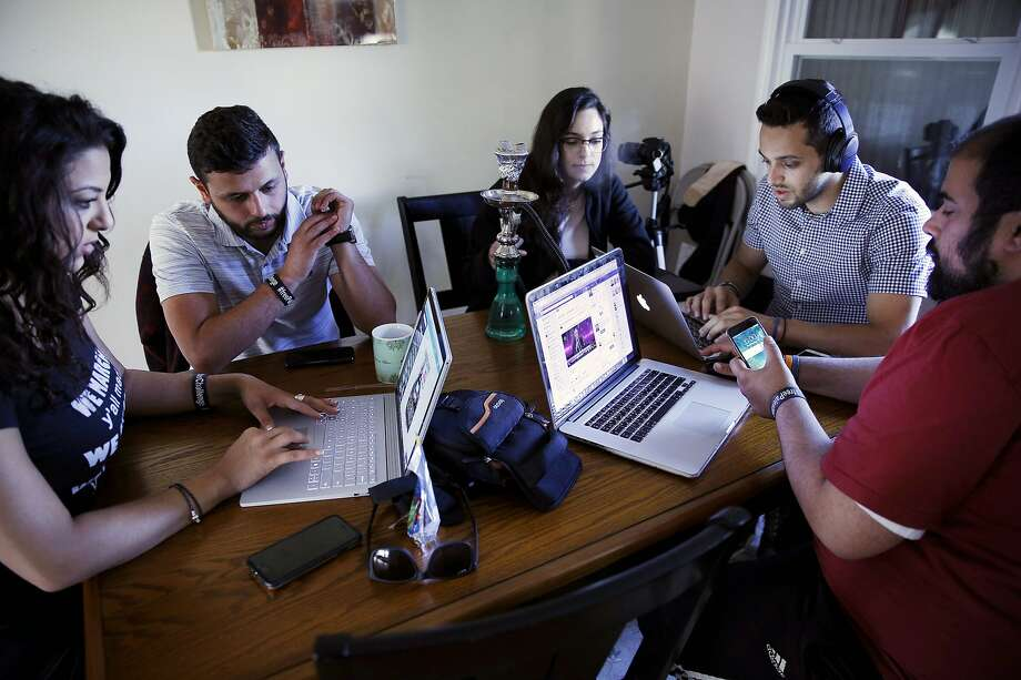 Arab Barghouti (second from left) and his friends plan work on a hunger strike campaign. Photo: Santiago Mejia, The Chronicle